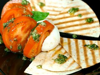 Mozzarella Fan with Tomatoes and Pesto Sauce -