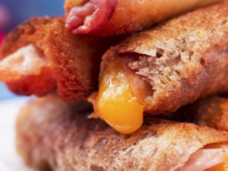 Bread-Wrapped Prosciutto and Cheddar Sticks -