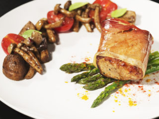 Prosciutto-Wrapped Pork with Asparagus and Mushrooms -