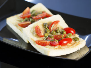 Roasted Garlic Toast with Capers and Cherry Tomatoes -