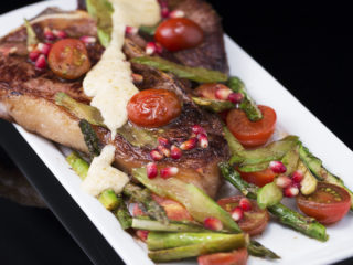 T-Bone Steak with Asparagus and Pomegranate Seeds -