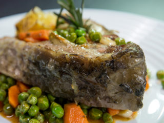 Roasted Carp Steak with Carrots and Peas -