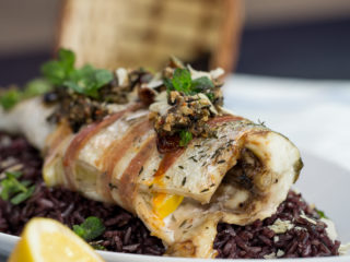 Pancetta-Wrapped Sea Bass with Rice -
