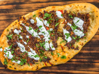 lahmajoun with yogurt topping