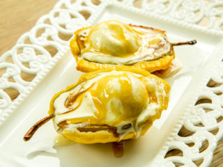 pears in puff pastry with ice cream on top