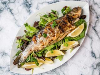 sea bass with garlic sauce and white wine