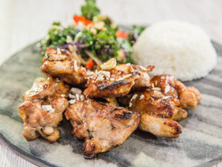 Marinated Chicken Thighs with Warm Kale Salad