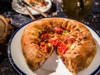 cheesy tomato fat outer rim pizza with salami