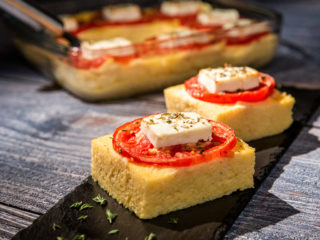 Baked Cheesy Polenta with Tomatoes