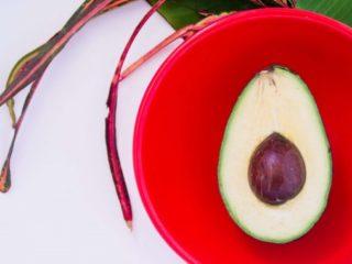 Avocado on a colored dish