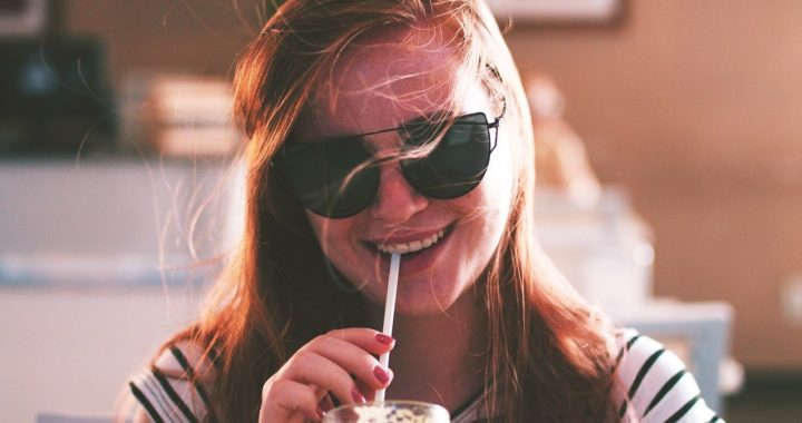 Young woman drinking almond milk smoothie