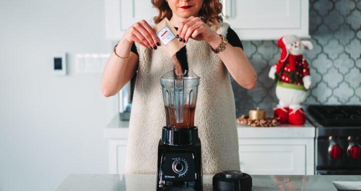Woman using a blender
