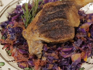 Braised duck legs with red cabbage and carrot